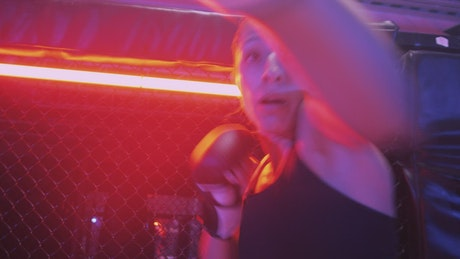 Point of view fighting in a ring against a woman