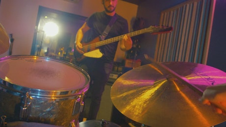 Point of view of a drummer playing in a group