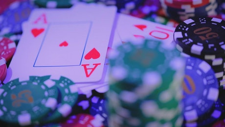 Poker cards surrounded by casino chips