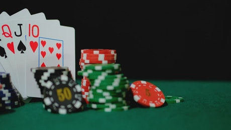 Poker chips and cards arranged in an image composition