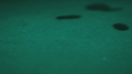 Poker chips falling on a gaming table