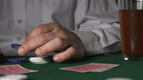 Poker player holding chips