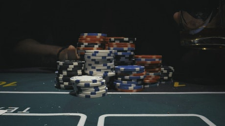 Poker player knocking down his chips