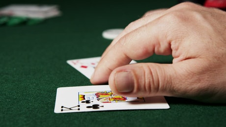 Poker player moving their cards