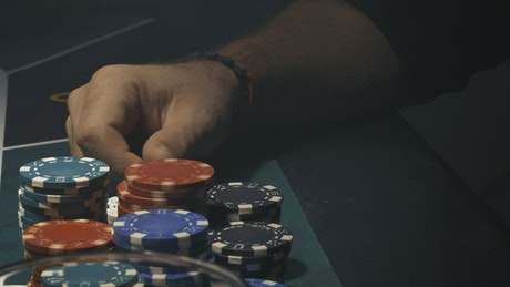 Poker player receives cards and bet