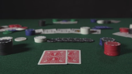 Poker player revealing two cards