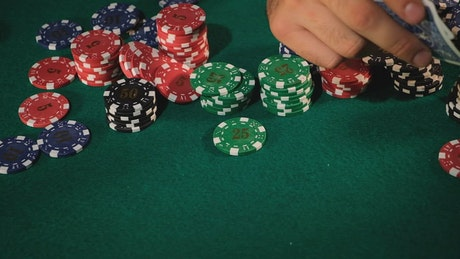 Poker player shows a pair of aces