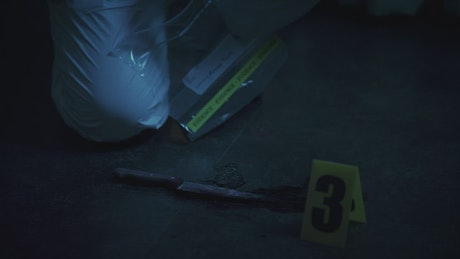 Police forensic guarding evidence at a crime scene