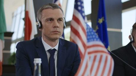Politician listening to translation headphones