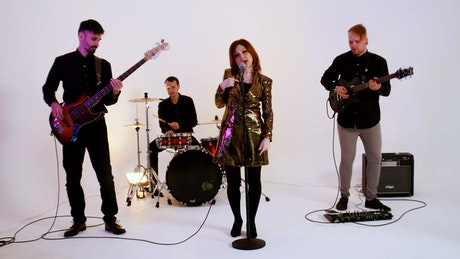 Pop band performing at a photo studio