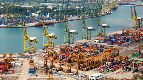 Port of Singapore with ships, cranes and containers