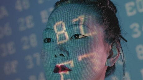 Portrait of a cyborg being programmed