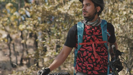 Portrait of a cyclist man in nature