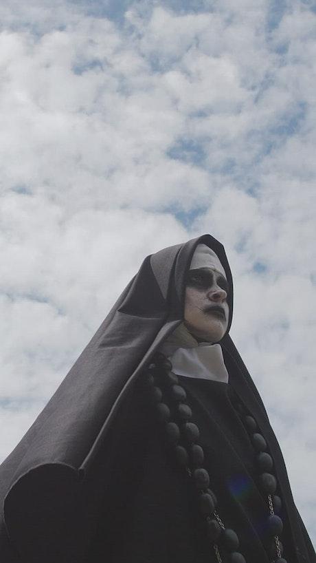 Portrait of a devilish nun smiling