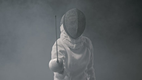 Portrait of a fencer who waves his sword