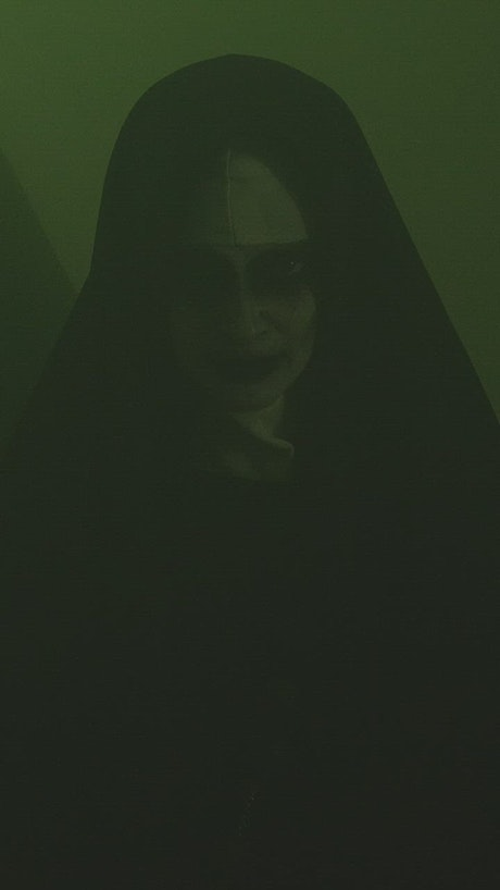 Portrait of a ghostly nun in a dark place