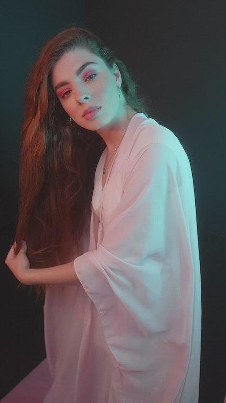 Portrait of a girl posing captivatingly on black background