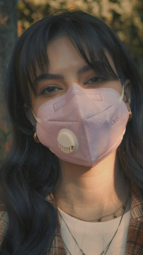 Portrait of a girl with a face mask
