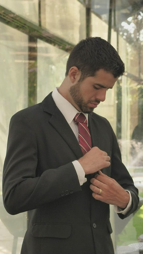 Portrait of a groom getting ready for his wedding