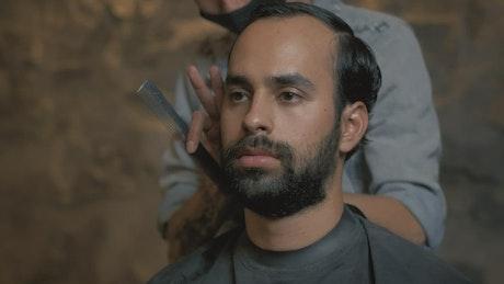 Portrait of a man during a haircut