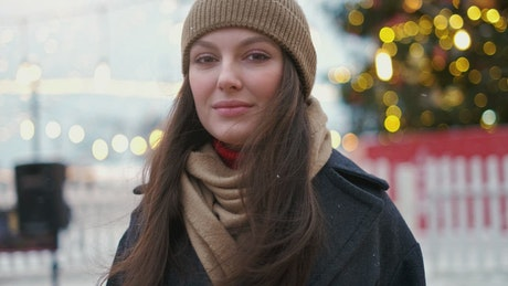 Portrait of a woman wearing a beanie at Christmas
