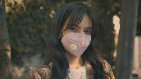 Portrait of a woman with face mask in the street