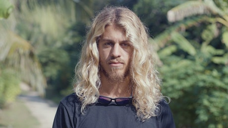 Portrait of blond surfer with long hair