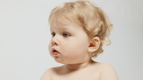 Portrait of blue-eyed baby in a photo studio