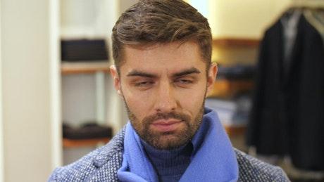Portrait of fashion man in a suit shop