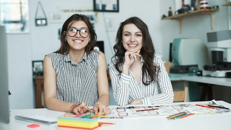 Portrait of two young architects at their office