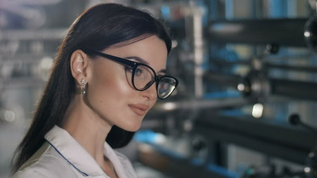 Portrait of woman in eyeglasses in factory