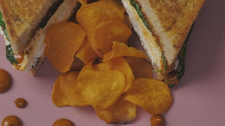Potato chips and a half-roasted sandwich