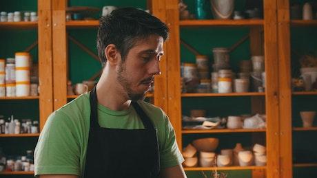 Pottery master examining a clay pot