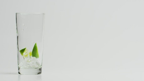 Pouring a glass of tonic water