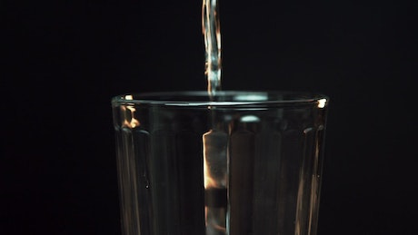 Pouring a glass of warm water