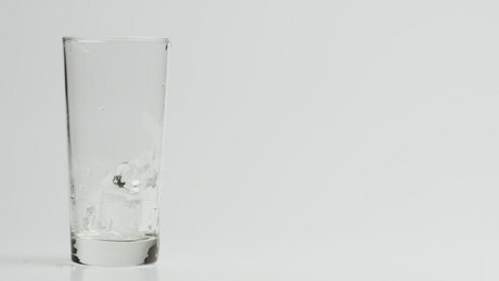 Pouring chocolate milk on a cristal glass