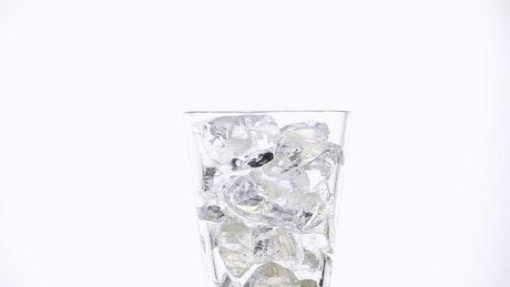 Pouring coke soda on a glass