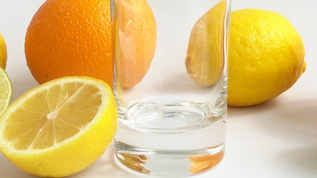 Pouring lemonade in a glass, close up