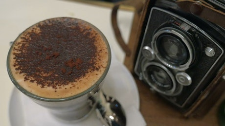 Pouring sugar into a hot coffee