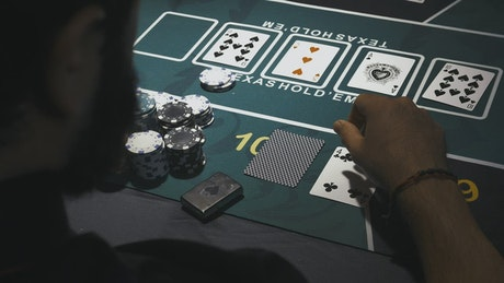 POV of a poker player looking at his card