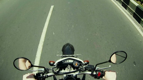 POV of motorcycle chopper driving on road