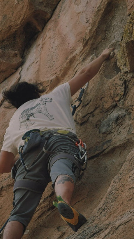 Practicing extreme mountaineering on a rocky mountain