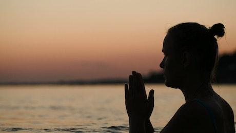Praying in the ocean