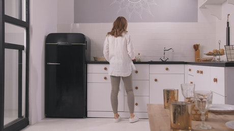 Pregnant woman in the kitchen