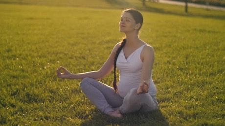 Pregnant woman meditating outdoor