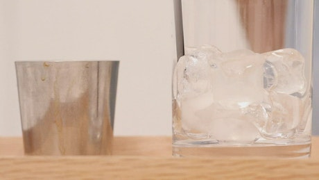 Preparing a cold beverage with coffee and milk in a glass