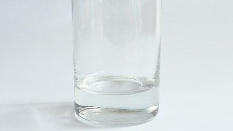 Preparing a drink in a glass