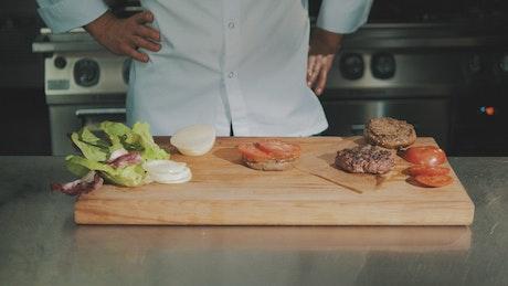 Preparing a hamburger in a kitchen