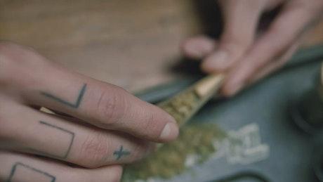 Preparing a marijuana cigarette