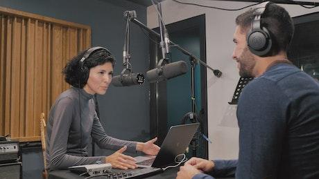 Presenters recording a podcast